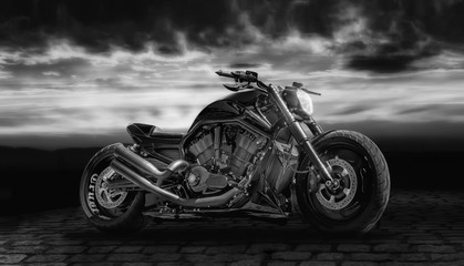 Composing with a motorcycle against dramatic sky in black and white