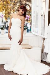 Beautiful Caucasian bride wearing wedding, looking over shoulder