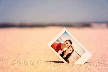 Retro Instant Photo Of Young Happy Couple On The Beach