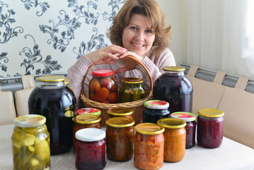 housewife with home canned vegetables in room