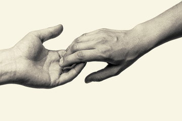 Black and white toned photo with two hands (farewell touch lovers)