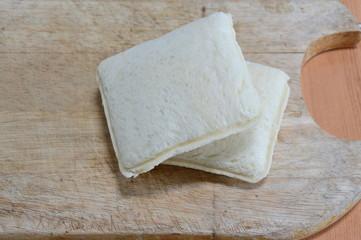 sandwich on wooden chop block