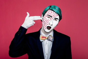 Boy shoots himself in the style of pop art. 