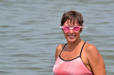 Woman after exercising swimming in the ocean