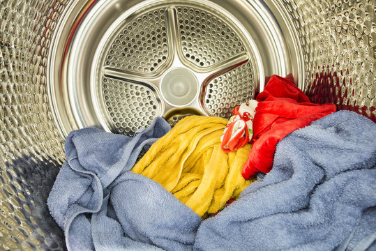 Inside of tumble dryer with drying laundry