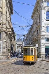 Milano con tram giallo in piazza cordusio e galleria Milan in Cordusio square and yellow train  in italy