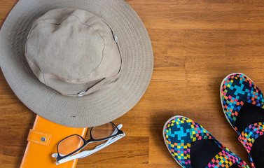 Travel concept with beautiful shoes, hut , glasses and notebook