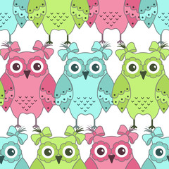Seamless pattern of colorful owls on a white background
