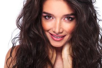 beautiful young woman smiling at the camera.