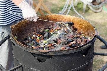 Large Pot of Hot Steaming Mussels Cooking Outdoors