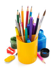 paint supplies and holder basket on white