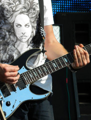 Rock musician playing electric guitar