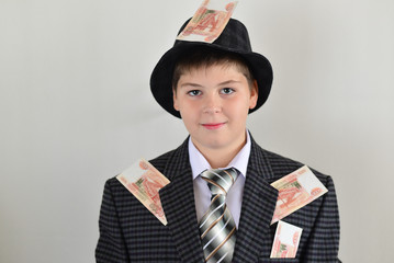 Boy teenager with sticking to clothes Russian money