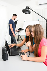 group of young photographer student on photography shooting workshop course indoor in a photo studio