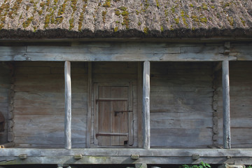 Old wooden barn with thatched roof