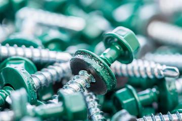 Many screws arranged as background