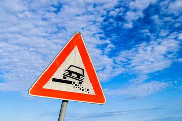 Hazardous Shoulder road sign on sky background