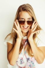 young blond woman in sunglasses smiling close up isolated on