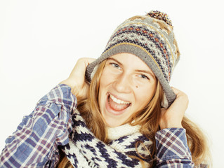 young pretty blond teenage girl in winter hat and scarf on white