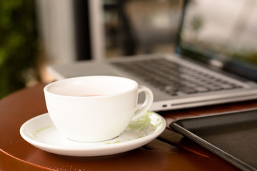 Working with laptop and cup of coffee