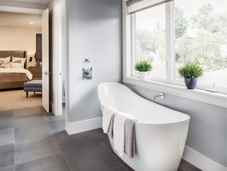 Bathtub in master bathroom in new luxury home with view of master bedroom