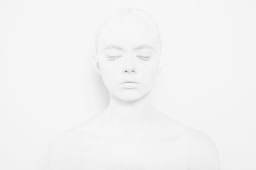 Girl with White Paint on the Skin on a White Background