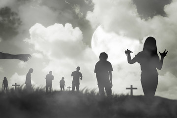 Silhouette group of zombie walking under full moon