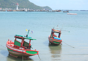 Small fishing boats near the island