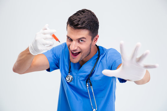 Portrait of a funny male doctor with syringe