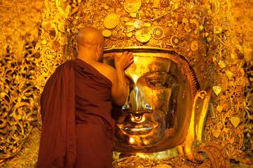MANDALAY-MAY 3:Burmese woman pray while The ritual of face wash