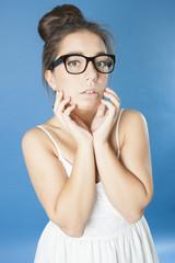 Portrait of a cute girl in glasses..