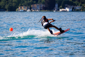 Young girl doing water sports on a lake