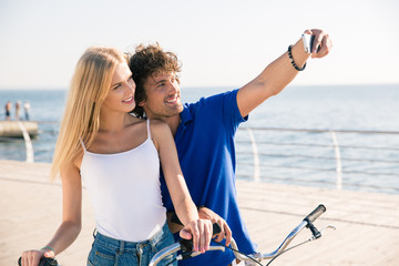 Man and woman making selfie photo on smartphone