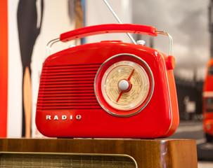 red retro radio on light background