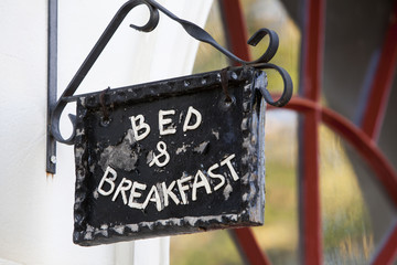 Metal Bed and Breakfast sign on building