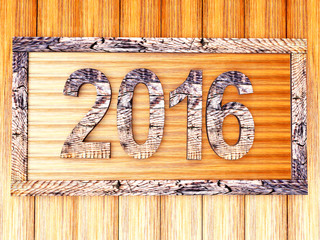 Wooden frame with 2016 on a wooden background