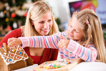 Christmas: Young Girl Uses Candy To Decorate Gingerbread House W