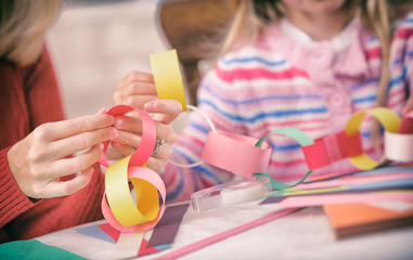 Christmas: Parent and Child Work On Paper Chain Garland