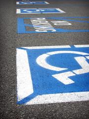 handicap and no parking warning on parking lot asphalt