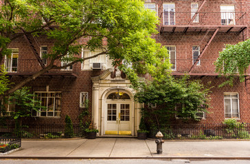 Old brownstone apartment building in Manhattan, New York city.