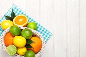 Citrus fruits in basket. Oranges, limes and lemons