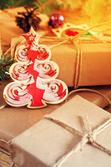 Christmas wooden toy Christmas tree stands on Christmas gifts cl