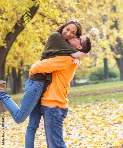 Boyfriend and girlfriend hugging and kissing