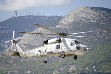 Sikorsky uh 60 black hawk mountain background transmission antenna