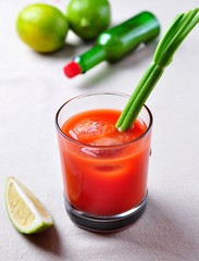 Bloody Mary cocktail with celery, Tabasco, pepper, sea salt and Worcestershire sauce