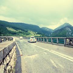 Car crossing Bridge over Tara river, Durmitor national park, Montenegro