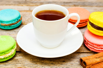 tea with macaroon and cinnamon