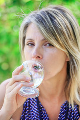 pretty woman drinking a glass of water