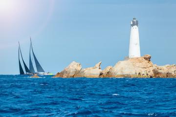 Fototapete - sailing in Sardinia, Monaci island lighthouse, Italy