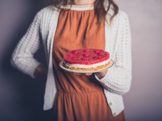 Young woman with cheesecake